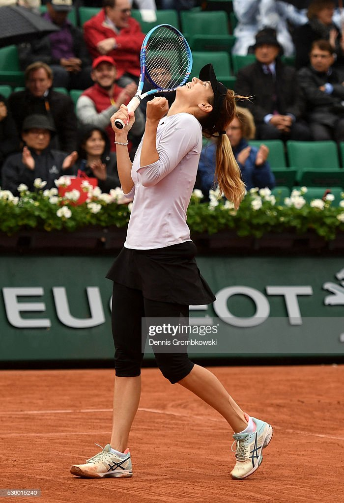 <a gi-track='captionPersonalityLinkClicked' href=/galleries/search?phrase=Tsvetana+Pironkova&family=editorial&specificpeople=600804 ng-click='$event.stopPropagation()'>Tsvetana Pironkova</a> of Bulgaria celebrates victory during the Ladies Singles fourth round match against Agnieszka Radwanska of Poland on day ten of the 2016 French Open at Roland Garros on May 31, 2016 in Paris, France.