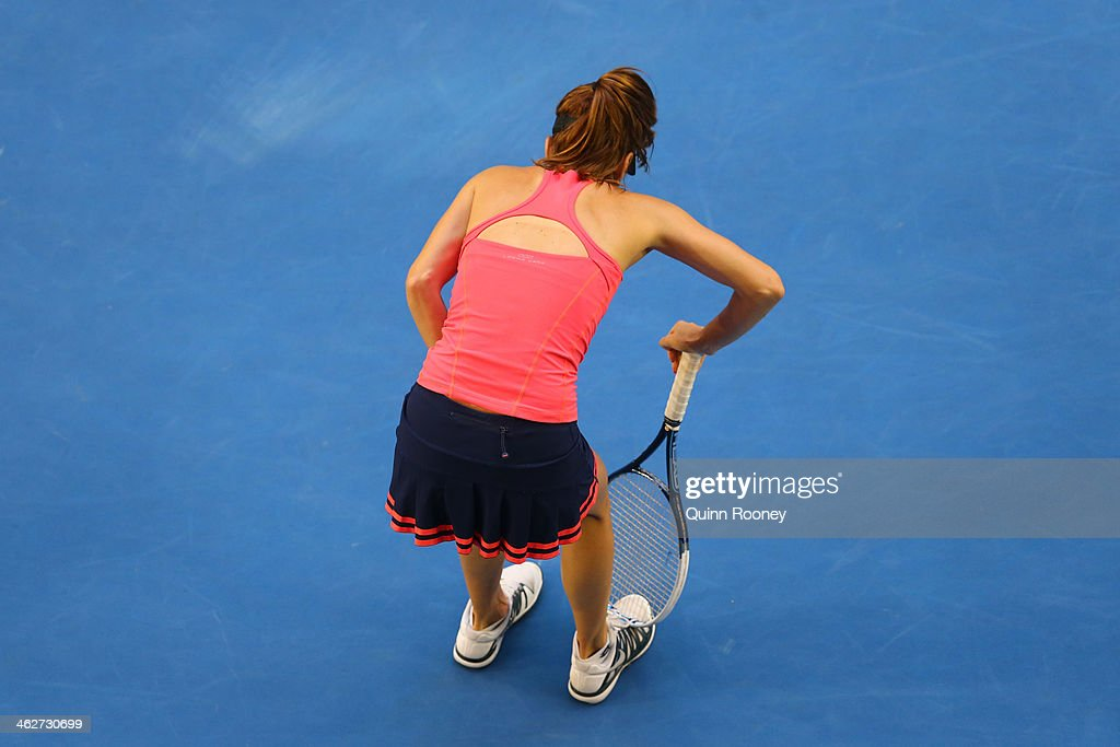 Tsvetana Pironkova of Bulgaria leans over in her second round match against Samantha Stosur of Australia during day three of the 2014 Australian Open at Melbourne Park on January 15, 2014 in Melbourne, Australia.