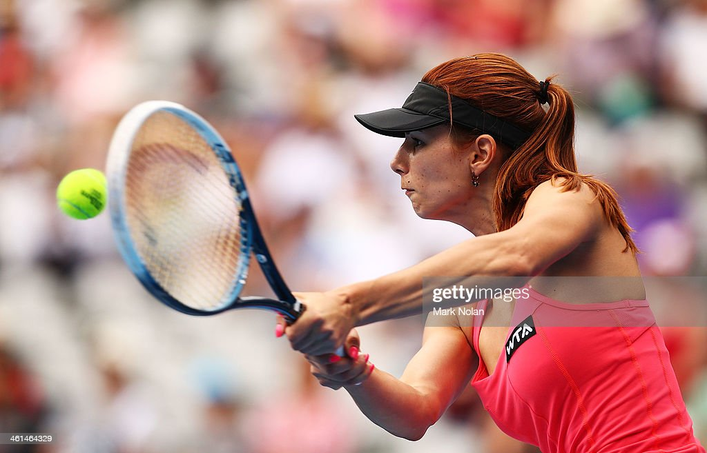 Tsvetana Pironkova of Bulgaria plays a backhand in her match against Petra Kvitova of the Czech Republic during day five of the 2014 Sydney International at Sydney Olympic Park Tennis Centre on January 9, 2014 in Sydney, Australia.