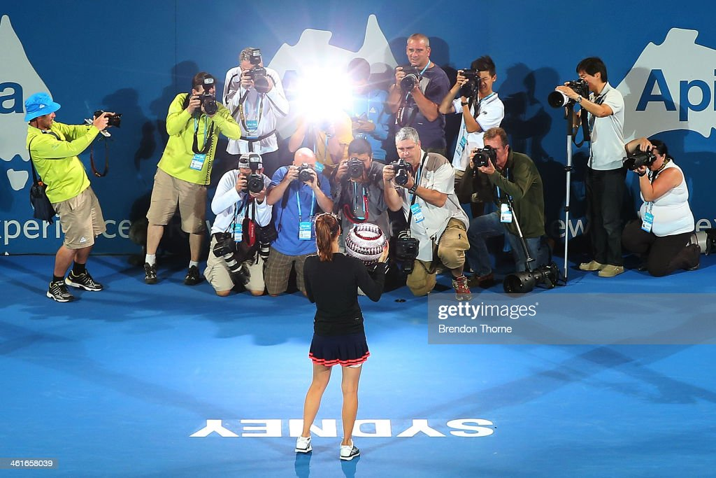 <a gi-track='captionPersonalityLinkClicked' href=/galleries/search?phrase=Tsvetana+Pironkova&family=editorial&specificpeople=600804 ng-click='$event.stopPropagation()'>Tsvetana Pironkova</a> of Bulgaria poses for photographers with the trophy after winning the womens singles final against Angelique Kerber of Germany during day six of the Sydney International at Sydney Olympic Park Tennis Centre on January 10, 2014 in Sydney, Australia.
