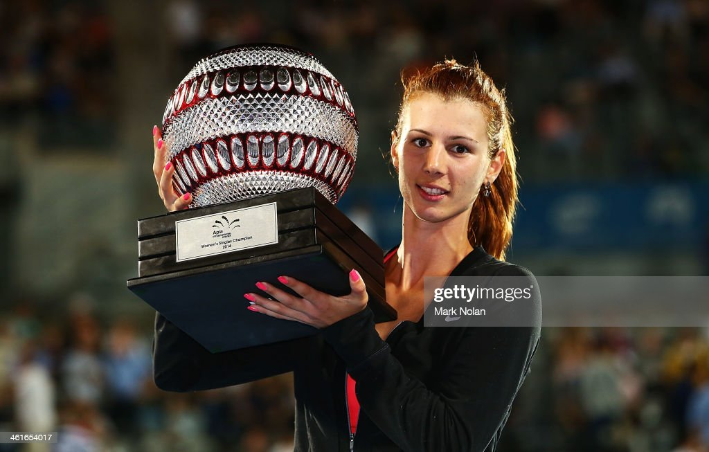 <a gi-track='captionPersonalityLinkClicked' href=/galleries/search?phrase=Tsvetana+Pironkova&family=editorial&specificpeople=600804 ng-click='$event.stopPropagation()'>Tsvetana Pironkova</a> of Bulgaria poses with the trophy after winning the Womens Singles Final match against Angelique Kerber of Germany during day six of the Sydney International at Sydney Olympic Park Tennis Centre on January 10, 2014 in Sydney, Australia.
