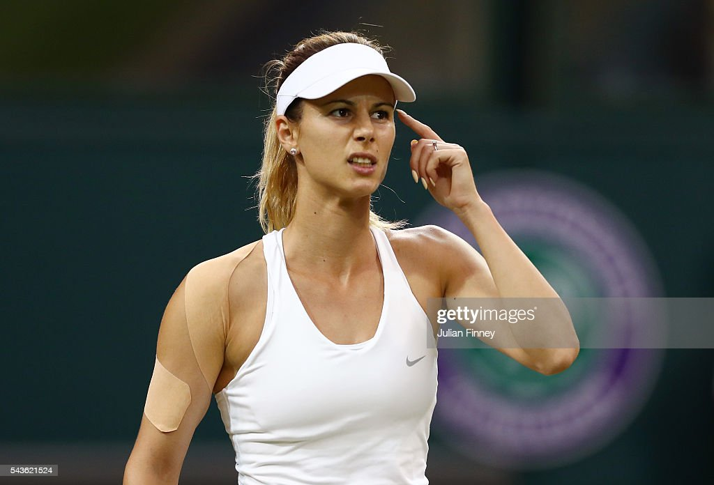 <a gi-track='captionPersonalityLinkClicked' href=/galleries/search?phrase=Tsvetana+Pironkova&family=editorial&specificpeople=600804 ng-click='$event.stopPropagation()'>Tsvetana Pironkova</a> of Bulgaria reacts during the Ladies Singles second round match against Belinda Bencic of Switzerland on day three of the Wimbledon Lawn Tennis Championships at the All England Lawn Tennis and Croquet Club on June 29, 2016 in London, England.
