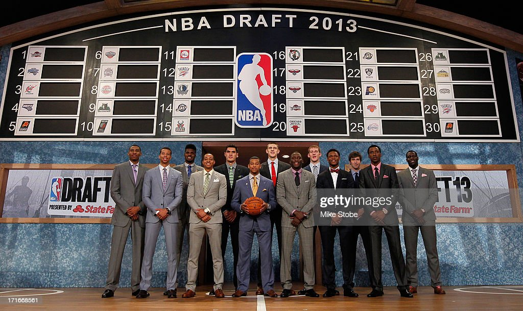 Tthe 2013 NBA Draft Class including <a gi-track='captionPersonalityLinkClicked' href=/galleries/search?phrase=Nerlens+Noel&family=editorial&specificpeople=7880842 ng-click='$event.stopPropagation()'>Nerlens Noel</a> of Kentucky, <a gi-track='captionPersonalityLinkClicked' href=/galleries/search?phrase=Victor+Oladipo&family=editorial&specificpeople=6681560 ng-click='$event.stopPropagation()'>Victor Oladipo</a> of Indiana, Otto Porter of Georgetown, Alex Len of Maryland, <a gi-track='captionPersonalityLinkClicked' href=/galleries/search?phrase=Ben+McLemore&family=editorial&specificpeople=9966388 ng-click='$event.stopPropagation()'>Ben McLemore</a> of Kansas, Trey Burke (front row C) of Michigan, Anthony Bennett of UNLV and MIchael Carter-Williams of Syracuse during the 2013 NBA Draft at Barclays Center on June 27, 2013 in in the Brooklyn Bourough of New York City.