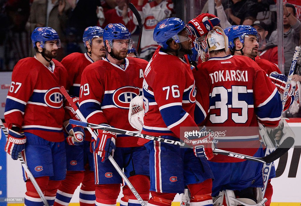 Tthe Montreal Canadiens celebrates after defeating the New York Rangers during Game Five of the Eastern Conference Final in the 2014 NHL Stanley Cup Playoffs at Bell Centre on May 27, 2014 in Montreal, Canada. Canadiens defeated the Rangers 7-4.