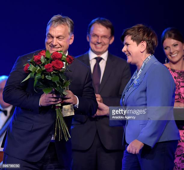 TThhe Polish Prime Ministe Beata Szydo delivers the prize to the Hungarian Prime MinisterViktor Orban witch has been award as Men of the Year by the...
