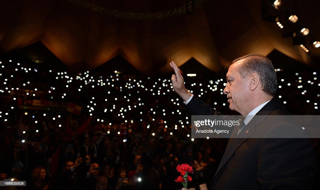 TTurkish Prime Minister Recep Tayyip Erdogan waves during the rally organized by the Union of European Turkish Democrats (UETD) at Tempodrom hall on February 4, 2014 in Berlin, Germany.