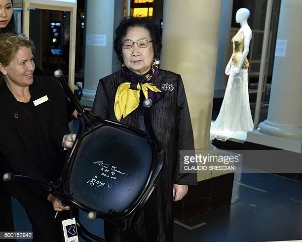 Tu Youyou of China Academy of Traditional Chinese Medicine in Beijing and Nobel Physiology or Medicine prize colaureate signs a chair at the Nobel...