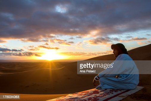 Tuareg and sunrise over the desert