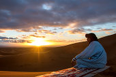 Tuareg and sunrise over the desert