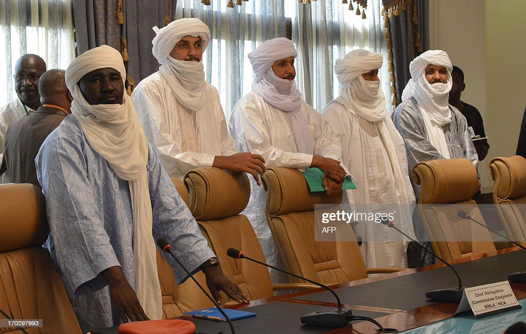 Tuareg delegates meet a Malian government delegation under the mediation of Burkina Faso's President and in the presence of United Nations, African Union and European Union representatives, on June 10, 2013, at the presidential palace in Ouagadougou. Mali's government has been struggling to reestablish its authority over all of the west African country after a March 2012 coup in Bamako created a power vacuum that saw Al-Qaeda linked Islamists and Tuareg rebels overrun the north. Burkina Faso's mediators hosting talks between Mali's government and armed Tuareg rebels said on June 10 they hoped for an agreement to enable elections to be held next month. AFP PHOTO / AHMED OUOBA