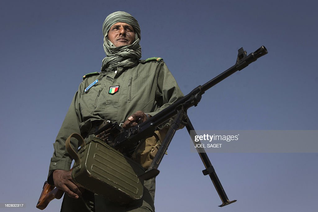 Tuareg Malian gendarme Hassan Ag Chaumin, 40 years old, is pictured near the Niger river on February 28, 2013 in the centre of northern Mali's largest city Gao. AFP PHOTO /JOEL SAGET