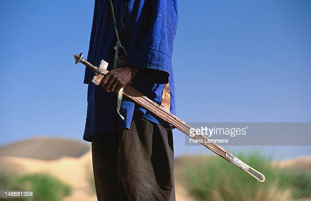 Tuareg man with sword (takouba) in Sahel region near Agadez.