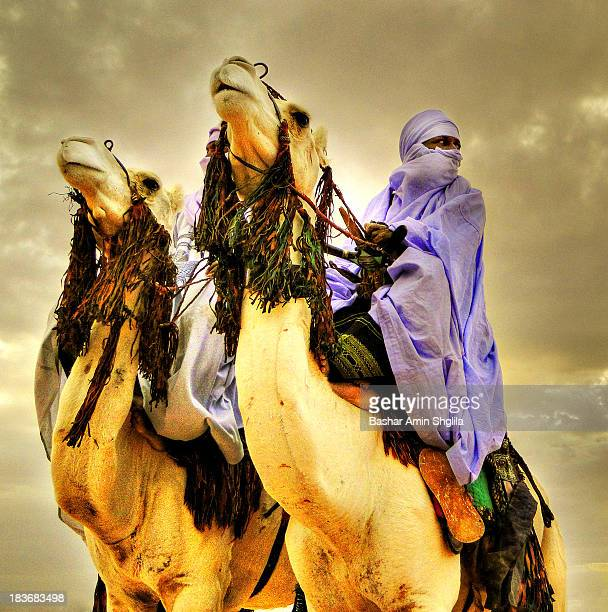 CONTENT] Tuareg of Daraj riding camels and showing their skills at daraj taureg festival in the Libyan desert