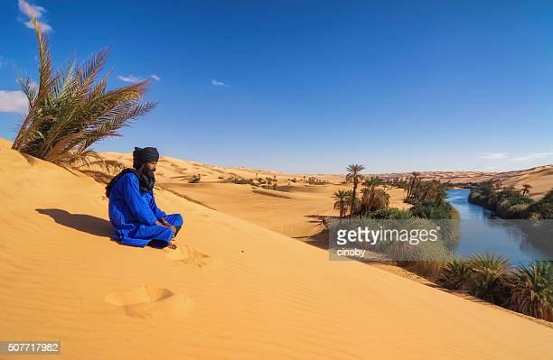 Tuareg on dune , Um el Ma , Mandara lake , Sahara, Libya