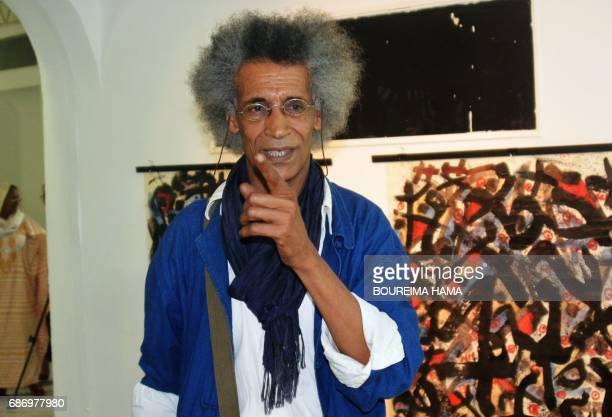 Tuareg poet and painter Hawad gestures in front of some of his artwworks on April 6 in Niamey The BoubouHama National Museum in Niamey and the...