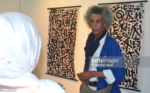 Tuareg poet and painter Hawad stands in front of some of his artwworks on April 6 in Niamey The BoubouHama National Museum in Niamey and the...