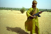 A Tuareg rebel poses with his AK47 in northern Mali