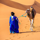 Tuareg with camel on Western Sahara Desert