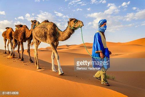 Tuareg with camel on Western Sahara Desert