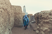 A Tuareg woman walking in the old city of Ghat which is located in the south east of Libya about 1,360 km (845 miles) south of Tripoli near of Algeria & Niger Border.