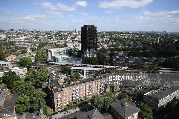 A tube train passes the remains of Grenfell Tower seen from a neighbouring tower block on June 16 2017 in London England 30 people have been...