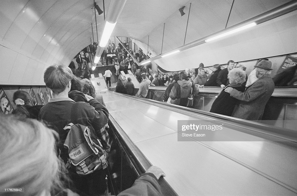 Tube travellers in the escalators at Tottenham Court Road underground station in London, England, United Kingdom, in January 1996.