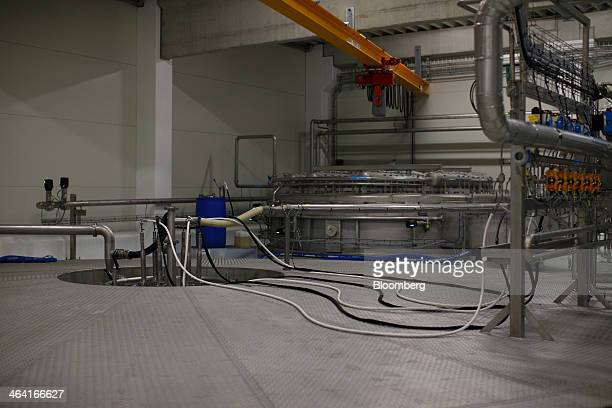 Tubes and pipes connect sections of yeast extract drying machinery at the Royal DSM NV site in Delft Netherlands on Monday Jan 20 2014 DSM fell the...