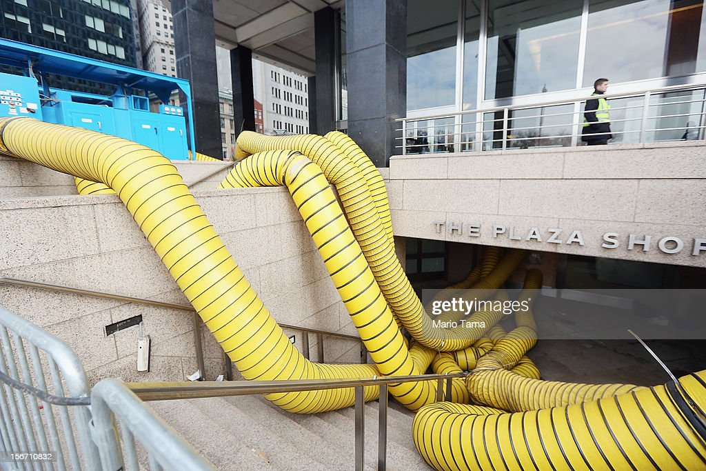 Tubes carry hot air being pumped into a Financial District building that flooded in an attempt to dry out the building following Superstorm Sandy in lower Manhattan on November 19, 2012 in New York City. Many of the office towers in the low lying Financial District which flooded remain closed due to damage to heating and electrical infrastructure. Many other buildings in the area are being powered by generators.