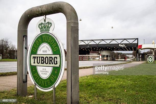 A Tuborg beer logo stands at the entrance to the Carlsberg A/S brewery in Fredericia Denmark on Sunday Feb 9 2014 The Copenhagenbased brewer is...