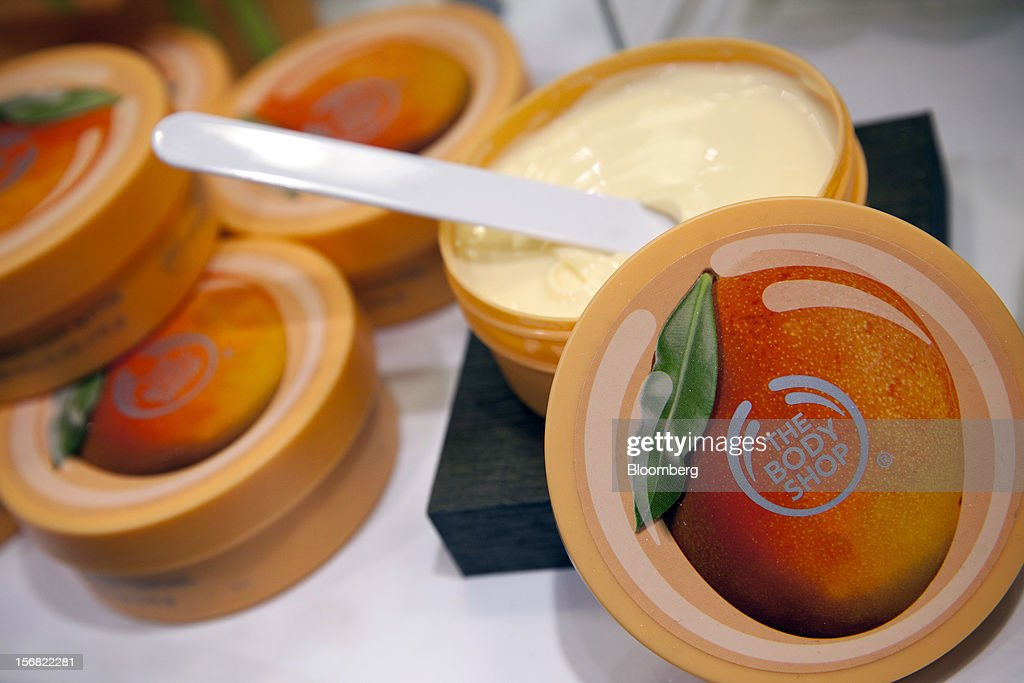 Tubs of Body Shop Mango Body Butter are seen on display at a store in Paris, France, on Wednesday, Nov. 21, 2012. Body Shop International Plc Chief Executive Officer Sophie Gasperment has introduced organic lines and updated products like Hemp Hand Protector with Community Fair Trade ingredients after L'Oreal, the world's largest maker of cosmetics, bought the company in 2006. Photographer: Balint Porneczi/Bloomberg via Getty Images
