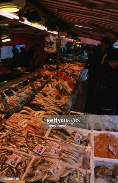 Tubs of fresh fish for sale at a seafood stall in the Albert Cuyp Market on Albert Cuypstraat.