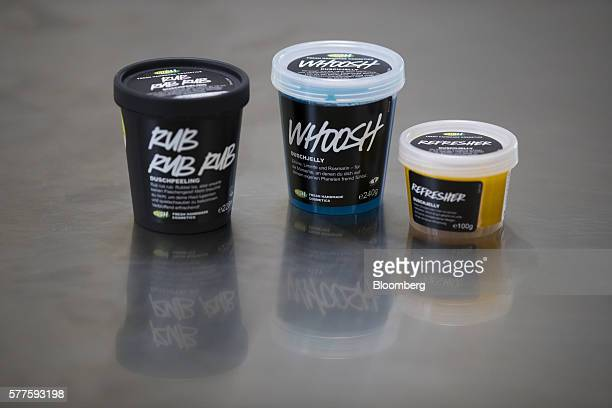 Tubs of 'Rub Rub Rub' 'Whoosh' and 'Refresher' shower gel scrubs sit on a workbench following manufacture at the Lush Cosmetics Ltd hand made...