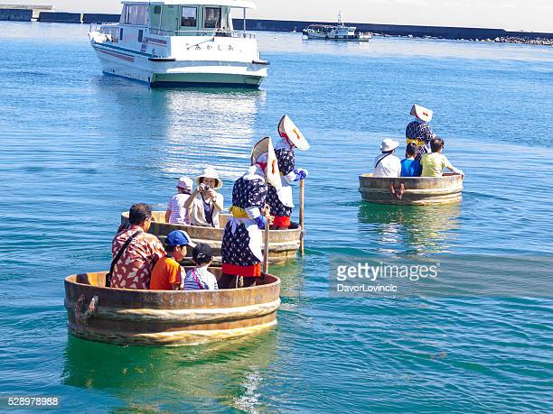 Tub-shaped boats with tourists in japan sea