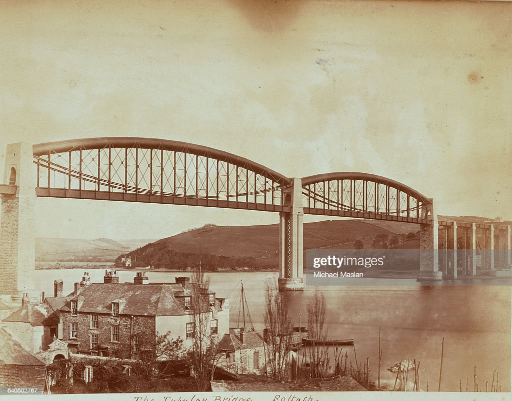 Tubular railroad bridge spans a wide river at Saltash Cornwall Photographed ca 1880