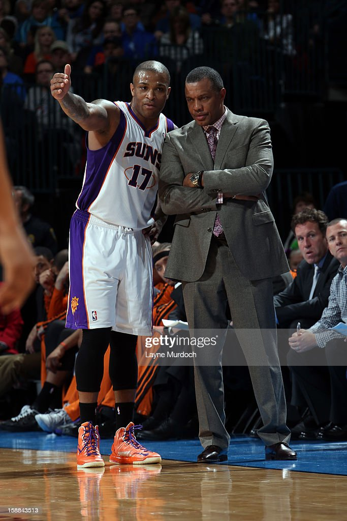 P.J. Tucker #17 and Head Coach Alvin Gentry of the Phoenix Suns talk things over against the Oklahoma City Thunder during an NBA game on December 31, 2012 at the Chesapeake Energy Arena in Oklahoma City, Oklahoma.