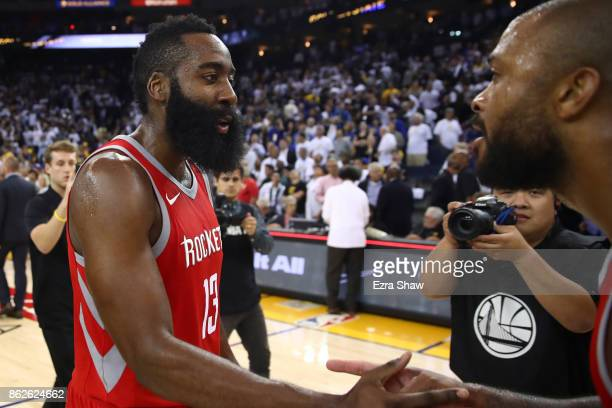 Tucker and James Harden of the Houston Rockets celebrate after defeating the Golden State Warriors 122121 in their NBA game at ORACLE Arena on...