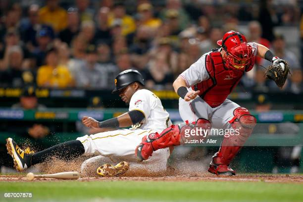 Tucker Barnhart of the Cincinnati Reds gets the force out at home against Gregory Polanco of the Pittsburgh Pirates in the third inning at PNC Park...