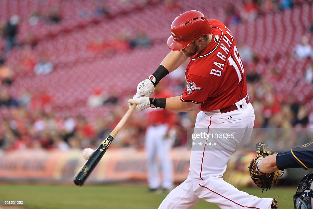 Tucker Barnhart #16 of the Cincinnati Reds hits an RBI single in the first inning against the Milwaukee Brewers at Great American Ball Park on May 5, 2016 in Cincinnati, Ohio.