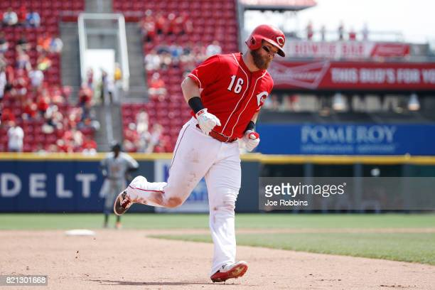 Tucker Barnhart of the Cincinnati Reds rounds the bases after a solo home run in the sixth inning of a game against the Miami Marlins at Great...
