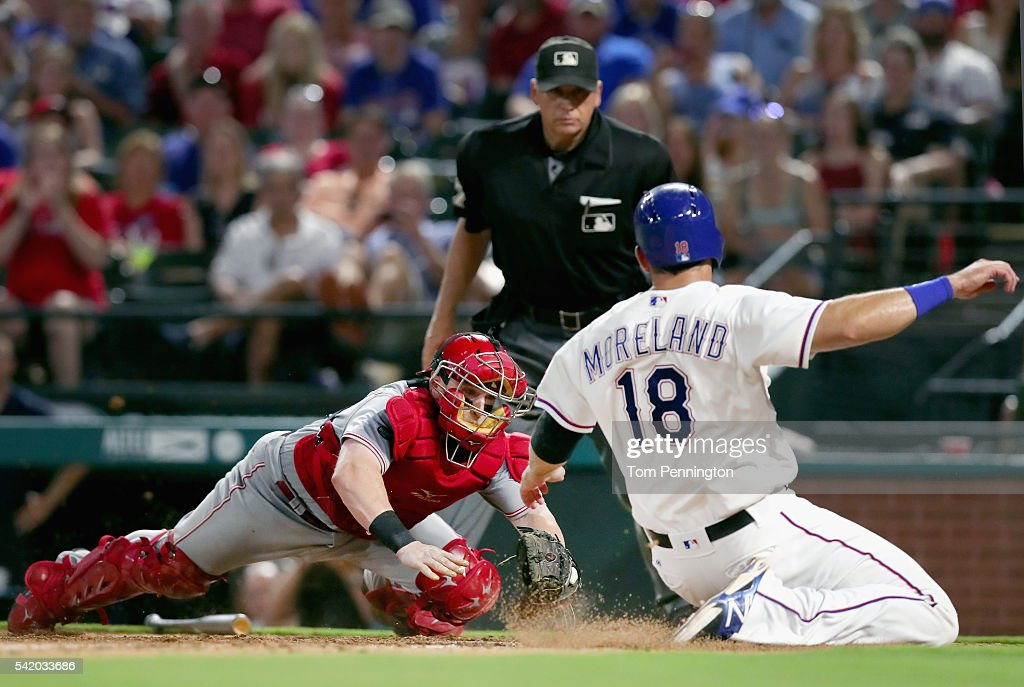 Tucker Barnhart #16 of the Cincinnati Reds tags out Mitch Moreland #18 of the Texas Rangers at home plate in the bottom of the eighth inning at Globe Life Park in Arlington on June 21, 2016 in Arlington, Texas.