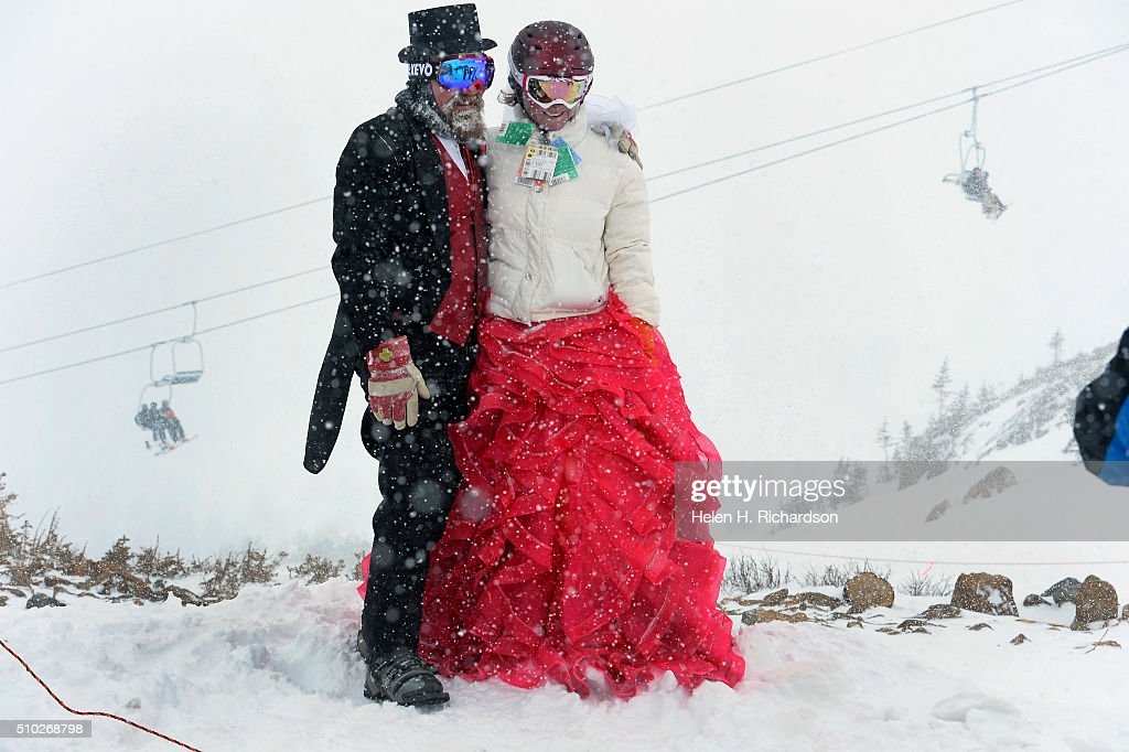 Tucker Brown and his wife Karyn, right, get a photo taken at around 12,000 feet at Loveland ski area before the 25th annual Mountaintop Matrimony Valentine's day wedding ceremony on February 14, 2016 at the Loveland Ski area near Georgetown, Colorado. The couple were married here in 2007 and have come back every year except for three to renew their vows. The ceremony was held at Ptarmigan Roost cabin at the top of Ptarmigan lift. Approximately 100 couples got married or renewed their vows with minister Harry Heilmann, of the Universal Life Church, overseeing the ceremony.