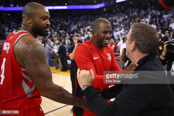 Tucker Chris Paul and team owner Tilman Fertitta of the Houston Rockets celebrate after defeating the Golden State Warriors 122121 in their NBA game...
