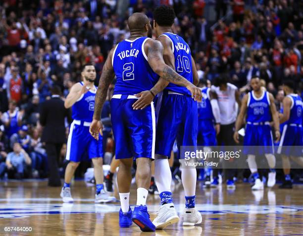 J Tucker congratulates DeMar DeRozan of the Toronto Raptors after he sunk a basket late in the 4th quarter of an NBA game against the Chicago Bulls...