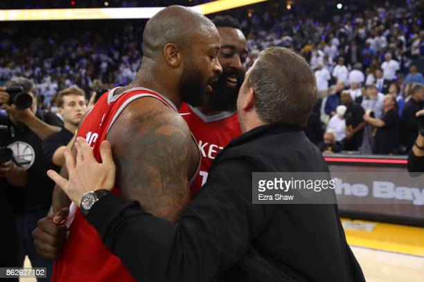Tucker James Harden and team owner Tilman Fertitta of the Houston Rockets celebrate after defeating the Golden State Warriors 122121 in their NBA...
