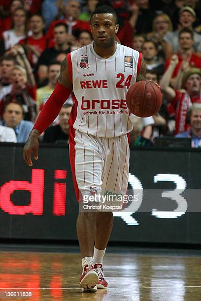 J Tucker of Brose Baskets Bamberg leads the ball during the Beko BBL match between Brose Baskets Bamberg and Bayern Muenchen at Stechert Arena on...