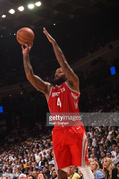 Tucker of the Houston Rockets handles the ball against the Golden State Warriors on October 17 2017 at ORACLE Arena in Oakland California NOTE TO...