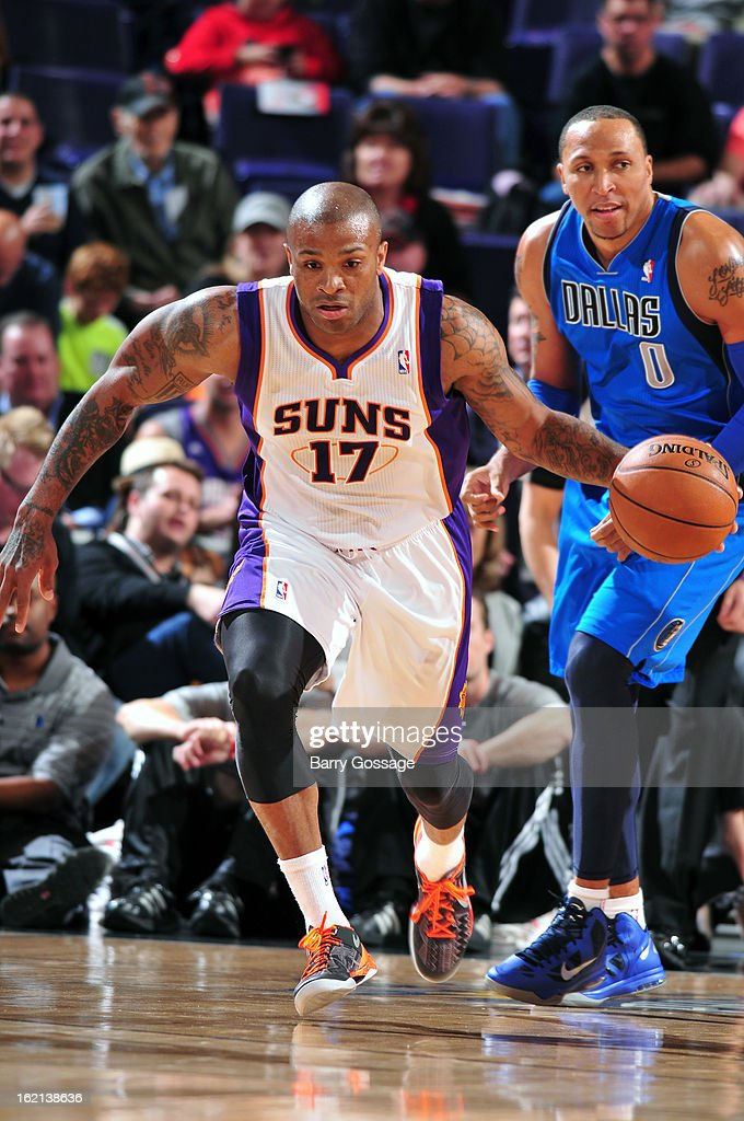 P.J. Tucker #17 of the Phoenix Suns brings the ball up court against the Dallas Mavericks on February 1, 2013 at U.S. Airways Center in Phoenix, Arizona.