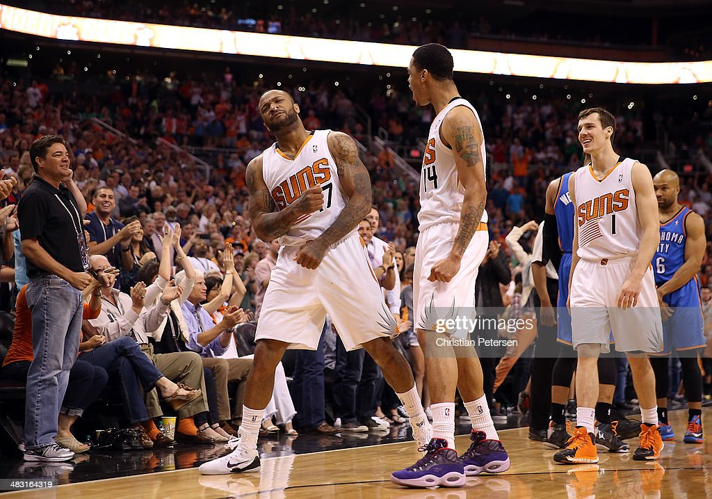 P.J. Tucker #17 of the Phoenix Suns celebrates with Gerald Green #14 and Goran Dragic #1 and Tucker after stole the ball and drew a foul from Derek Fisher #6 of the Oklahoma City Thunder during the second half of the NBA game at US Airways Center on April 6, 2014 in Phoenix, Arizona. The Suns defeated the Thunder 122-115.