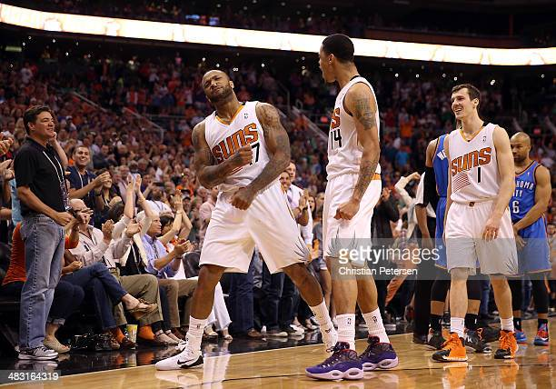J Tucker of the Phoenix Suns celebrates with Gerald Green and Goran Dragic and Tucker after stole the ball and drew a foul from Derek Fisher of the...