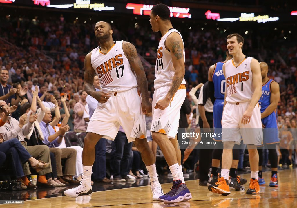 P.J. Tucker #17 of the Phoenix Suns celebrates with Gerald Green #14 and Goran Dragic #1 after Tucker stole the ball and drew a foul from Derek Fisher #6 of the Oklahoma City Thunder during the second half of the NBA game at US Airways Center on April 6, 2014 in Phoenix, Arizona. The Suns defeated the Thunder 122-115.